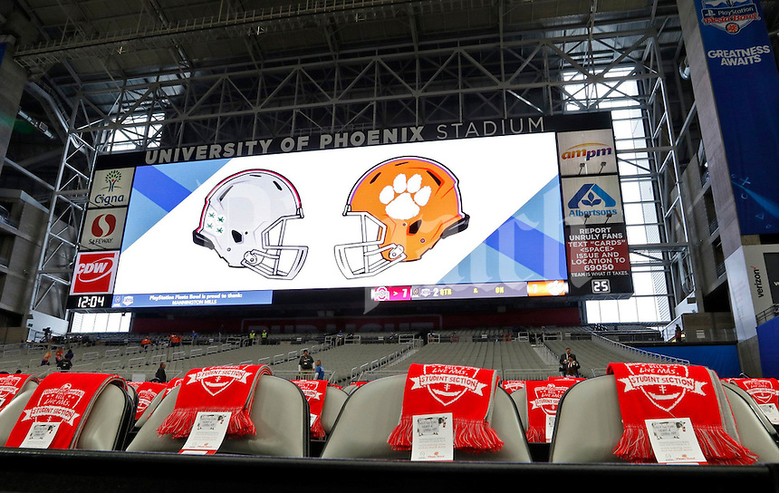 Red scarves sit in seats designated for Ohio State students prior to the College Football Playoff semifinal Fiesta Bowl against the Clemson Tigers at University of Phoenix Stadium in Glendale, Arizona on Dec. 31, 2016. (Barbara J. Perenic/The Columbus Dispatch)
