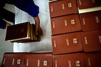 "An Amity Printing Company employee arranges newly-completed Bibles in the Amity Printing Company's new printing facility in Nanjing, China....On May 18, 2008, the Amity Printing Company in Nanjing, Jiangsu Province, China, inaugurated its new printing facility in southern Nanjing.  The facility doubles the printing capacity of the company, now up to 12 million Bibles produced in a year, making Amity Printing Company the largest producer of Bibles in the world.  The company, in cooperation with the international organization the United Bible Societies, produces Bibles for both domestic Chinese use and international distribution.  The company's Bibles are printed in Chinese and many other languages.  Within China, the Bibles are distributed both to registered and unregistered Christians who worship in illegal ""house churches."""