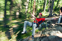 Pfunds, Tiroler Oberland, Austria, August 2009. climbing from tree to tree over an obstacle course in the tree tops of the houchseil kletterpark. crossing the Inn River on a Flying Fox, and a primitive cable bridge. Photo by Frits Meyst/Adventure4ever.com