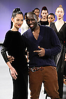 British fashion designer Romero Bryan, walk runway with models at the close of the Romero Bryan Autumn Winter 2012 fashion show, during Couture Fashion Week New York Fall 2012.