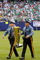 Two New Jersey State Troopers carry the Gold Cup trophy onto the field after the game. Mexico (MEX) defeated the United States (USA) 5-0 during the finals of the CONCACAF Gold Cup at Giants Stadium in East Rutherford, NJ, on July 26, 2009.