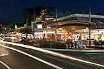 View along the Esplanade illuminated at night.  Cairns, Queensland, Australia