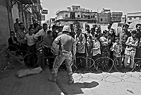 Baghdad, Iraq, April 11, 2003.Frustrated Iraqi civilians try to communicate with US Army personel to persuade them to let them cross the river to go home, as US forces keep most of the bridges across the Tigris river closed to trafic.