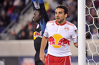 Dwayne De Rosario (11) of the New York Red Bulls guards the near post on a corner kick. The New York Red Bulls  and the Houston Dynamo played to a 1-1 tie during a Major League Soccer (MLS) match at Red Bull Arena in Harrison, NJ, on April 02, 2011.