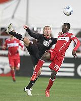 Kurt Morsink #6 of D.C. United kicks the ball over Patrick Nyarko #14 of the Chicago Fire during an MLS match on April 17 2010, at RFK Stadium in Washington D.C. Fire won the match 2-0.