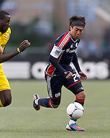 New England Revolution midfielder Lee Nguyen (24) on the attack. In a Major League Soccer (MLS) match, the New England Revolution tied the Columbus Crew, 0-0, at Gillette Stadium on June 16, 2012.