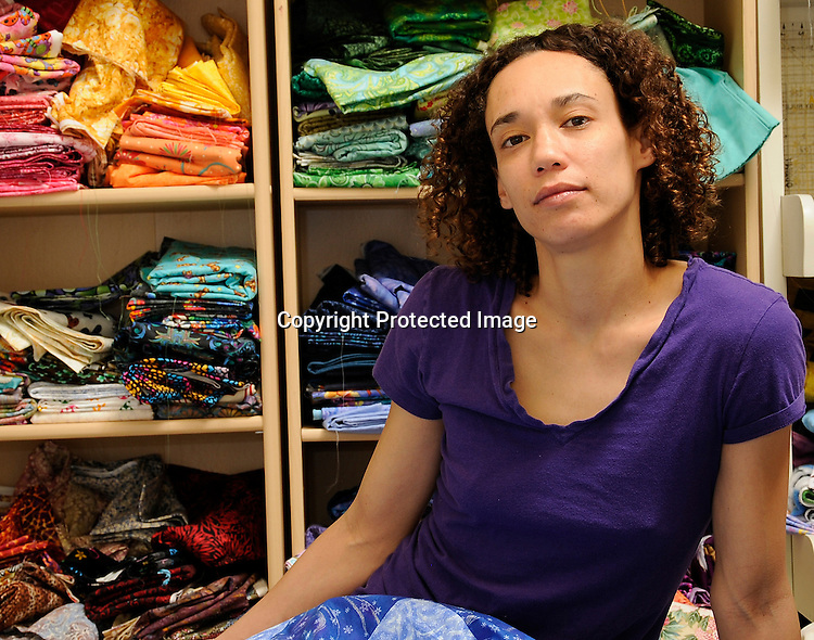 Stock photo of a Young Afro American Textile Worker