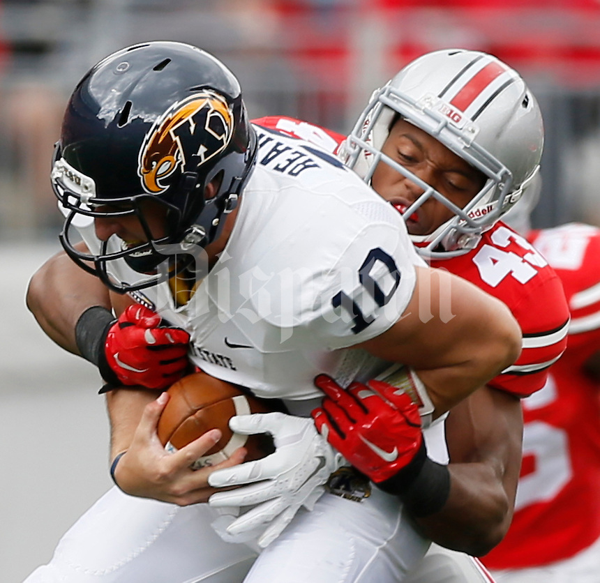 Ohio State Buckeyes linebacker Darron Lee (43) tackles Kent State Golden Flashes quarterback Colin Reardon (10) during Saturday's NCAA Division I football game at Ohio Stadium in Columbus on September 13, 2014. Ohio State won the game 66-0. (Dispatch Photo by Barbara J. Perenic)