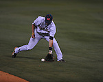 Ole Miss' Alex Yarbrough (2) knocks down a ground ball on a single by a Kentucky batter at Oxford-University Stadium in Oxford, Miss. on Friday, April 15, 2011. Ole Miss won 3-2.