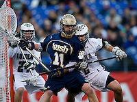 Steve Layne (2) of Loyola tries to stop Neal Hicks (11) of Notre Dame during the Face-Off Classic in at M&T Stadium in Baltimore, MD