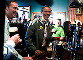United States President Barack Obama visits a bar in celebration of St. Patrick's day at the Dubliner Restaurant and Pub on March 17, 2012 in Washington, DC. Next week, Obama and Vice President Biden will meet the Irish Prime Minister Enda Kenny and attend a St. Patrick's Day lunch at the Capitol..Credit: Joshua Roberts / Pool via CNP