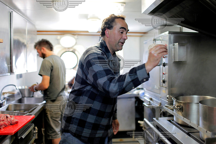 Spanish fisherman, Javier Sarobe, cooks a traditional Marmitako (Basque tuna stew) for the crew on board the Arctic Sunrise in Bayonne. Greenpeace is on a European journey in support of sustainable fishing, to meet with local representatives from the growing movement and to support reform of the European fisheries policy.