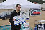 Joseph Latham holds a sign in support of Mitt Romney outside the polls at the Oxford Mall in Oxford, Miss. on Tuesday, November 6, 2012. (AP Photo/Oxford Eagle, Bruce Newman)