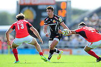 Henry Slade of Exeter Chiefs takes on the Saracens defence. Aviva Premiership match, between Exeter Chiefs and Saracens on September 11, 2016 at Sandy Park in Exeter, England. Photo by: Patrick Khachfe / JMP