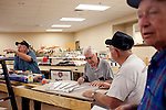 "Jerry ""Ski"" Mohalski, (left to right), George King, Harvey Peterson, and Jim Ciha work alongside model railroad tracks in the Sun City Model Railroad Club in the Fairway Recreation Center December 9, 2010. The railroad, which is new due to the building being renovated, will be 1100 feet of track when it is done. ..2010 marks the 50th anniversary of Sun City, America's first retirement city that remains the largest today with more than 40,000 residents 55 and older."