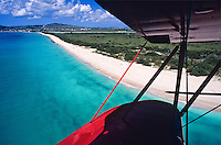 Flying over Sandy Point Wildlife Refuge.in a red bi-plane.St. Croix.U.S. Virgin Islands