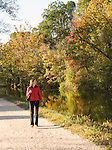 Washington DC; USA: Along the C&O Canal, or Chesapeake and Ohio Canal. Woman hiker enjoying fall foliage along canal, near Georgetown, model released..Photo copyright Lee Foster Photo # 28-washdc75422