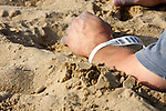 Tracking ID tag on a mass casualty incident male victim on a beach