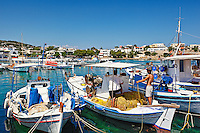 Fishermen with net at the port of Souvala in Aegina island, Greece