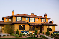 Home exterior, street view of a Tuscan style upper class luxury home located in Fort Collins, Colorado.