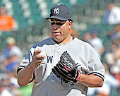 New York Yankees pitcher Bartolo Colon (40) seems to be talking to the ball as he pitches in the eighth inning against the Baltimore Orioles at Oriole Park at Camden Yards in Baltimore, Maryland in the first game of a doubleheader on Sunday, August 28, 2011.  The Orioles won the game 2 - 0..Credit: Ron Sachs / CNP.(RESTRICTION: NO New York or New Jersey Newspapers or newspapers within a 75 mile radius of New York City)