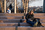 01/24/2012 - Medford/Somerville, Mass. - Megan Krey, G12, enjoys an unseasonably warm winter afternoon at Alex's place on the Tisch Library roof on Tuesday, January 24, 2012.   (Alonso Nichols/Tufts University)