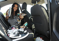NWA Democrat-Gazette/FLIP PUTTHOFF <br /> Her car is her office where Monica Gutierrez carries shoes for the array of business and fitness activities she enjoys, including dancing, cycling and working out. Tools for carpentry and other work may be found in the front seat.