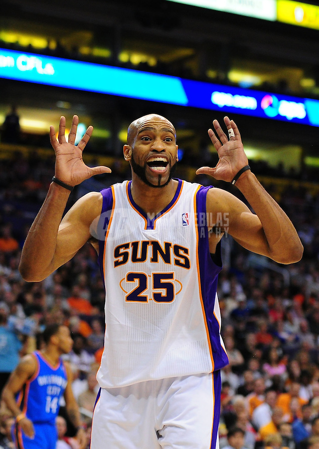 Mar. 30, 2011; Phoenix, AZ, USA; Phoenix Suns guard Vince Carter reacts in the fourth quarter against the Oklahoma City Thunder at the US Airways Center. The Thunder defeated the Suns 116-98. Mandatory Credit: Mark J. Rebilas-