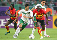 Zinha (7) of Mexico is chased by Mendonca (14) of Angola. Mexico and Angola played to a 0-0 tie in their FIFA World Cup Group D match at FIFA World Cup Stadium, Hanover, Germany, June 16, 2006.