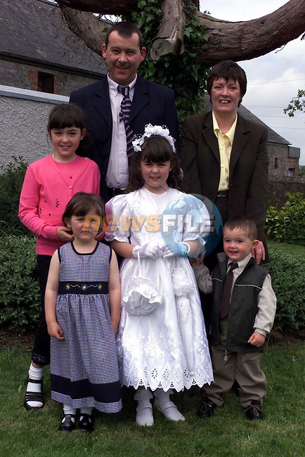 Selina Gorman after making her first communion in Duleek with her sisters Cicara and Elaine Brother Dillon and Parents Gerry & Breda..Picture Fran Caffrey Newsfile