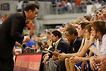 UK Head Coach John Calipari talks to the team during the second half of the University of Kentucky vs. University of Florida men's basketball game at the O'Connell Center in Gainesville, Fl., on Tuesday, February 12, 2013. UK lost 69-52. Photo by Tessa Lighty | Staff