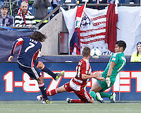 FC Dallas goalkeeper Raul Fernandez (1) moves to block New England Revolution forward Juan Toja (7) shot..  In a Major League Soccer (MLS) match, FC Dallas (red) defeated the New England Revolution (blue), 1-0, at Gillette Stadium on March 30, 2013.