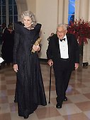 Nancy and Henry Kissinger arrive at the State Dinner for China's President President Xi and Madame Peng Liyuan at the White House in Washington, DC for an official State Visit Friday, September 25, 2015. Credit: Chris Kleponis / CNP