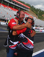 Jun 21, 2015; Bristol, TN, USA; Crew members celebrate the win by NHRA pro mod driver Rickie Smith during the final round of the Thunder Valley Nationals at Bristol Dragway. Mandatory Credit: Mark J. Rebilas-
