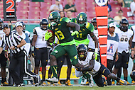 Tampa, FL - September 2, 2016: South Florida Bulls running back Darius Tice (13) avoids a tackle by Towson Tigers cornerback Justice Pettus-Dixon (17) during game between Towson and USF at the Raymond James Stadium in Tampa, FL. September 2, 2016.  (Photo by Elliott Brown/Media Images International)