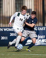 Austin Martz (2) of Georgetown fights for the ball with Dewey Lewis (14) of Michigan State during the third round of the NCAA tournament at Shaw Field in Washington, DC. Michigan State defeated Georgetown, 1-0.