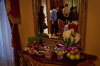Los Angeles, California, March 20, 2011 - A display of the seven S's celebrating Nowruz, the Persian New Year at the home of Sharona and Daniel Nazarian in Beverly Hills. The holiday also falls on Mr. Nazarian's birthday, so one of the decorated eggs wishes him a happy birthday. Ms. Nazarian includes a Torah on the table signifying their Jewish fatih. ..Nowruz, the Persian New Year, marks the first day of spring and the beginning of the Persian calendar. It is marked by Haft Sin, or the seven S's, which include sabzeh (wheat, barley or lentil sprouts growing in a dish - symbolizing rebirth); samanu (a sweet pudding made from wheat germ -symbolizing affluence); senjed (the dried fruit of the oleaster tree - symbolizing love); s?r (garlic - symbolizing medicine); s?b (apples - symbolizing beauty and health); somaq (sumac berries - symbolizing the sunrise); serkeh (vinegar - symbolizing age and patience). Each of these items are laid on a table in the home. Other items include decorated eggs, symbolizing fertility, a mirror symbolizing cleanliness and honesty and a bowl with goldfish, symbolizing life within life. ..