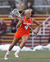 Syracuse University midfielder Erica Bodt (4) on the attack.   Syracuse University (orange) defeated Boston College (white), 17-12, on the Newton Campus Lacrosse Field at Boston College, on March 27, 2013.