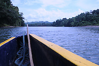 Looking down the Rio Napo from bow of motorized canoe in jungle of eastern Ecuador.