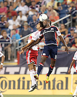 New York Red Bulls midfielder Mehdi Ballouchy (10) and New England Revolution midfielder Clyde Simms (19) battle for head ball. In a Major League Soccer (MLS) match, New England Revolution defeated New York Red Bulls, 2-0, at Gillette Stadium on July 8, 2012.