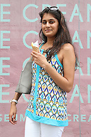 NEW YORK, NY - JULY 29:  A woman enjoys her free ice cream cone from The Museum of Ice Cream pop up shop in The Meatpacking District where patrons were offered free treats from 11am-3pm  in New York, New York on July 29, 2016.  Photo Credit: Rainmaker Photo/MediaPunch