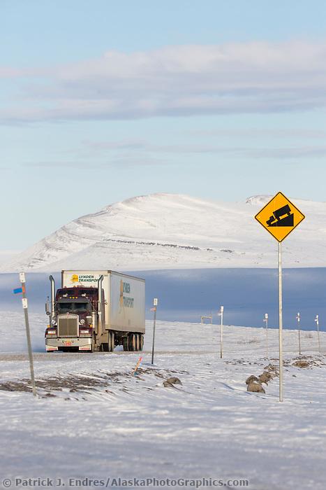 Trucks travel along the James Dalton Highway near Slope mountain in Arctic, Alaska.