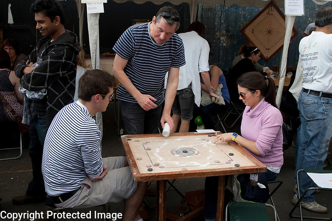 Couple Playing Carrom at the Carrom, Sunday Up Market, Brick Lane, London
