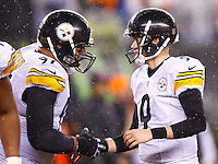 Chris Boswell #9 of the Pittsburgh Steelers is congratulated by teammate Cameron Heyward #97 after kicking the game-winning field goal against the Cincinnati Bengals in the fourth quarter during the Wild Card playoff game at Paul Brown Stadium on January 9, 2016 in Cincinnati, Ohio. (Photo by Jared Wickerham/DKPittsburghSports)
