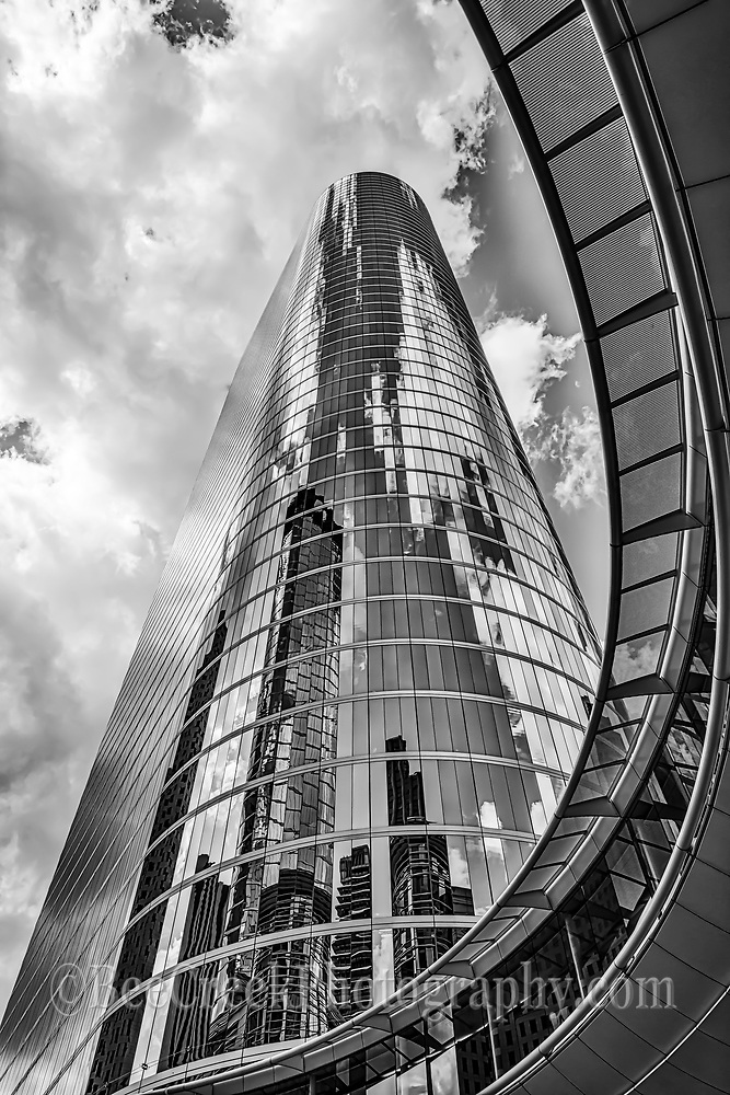 Houston is a city with lot of skyscrapers that tower above the city. We took this black and white version of the Chevron Complex on smith street formerly the Enron buildings, as they towered above the ground with their modern mirrored skyscraper where the high rise seem to rise up into the clouds.