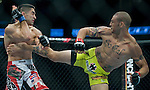 Cub Swanson, yellow trunks, kicks Ricardo Lamas in the chest during Saturday's UFC on Fox event at the Honda Center.