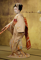 Meiko dancing,  Kyoto, Japan. Meikos are apprentice learning the profession ofa Geiko (better known as Geishas, as they are called in Tokyo). A meiko Kimono is different from a Geiko Kimono: long sleeves, more colorful, elaborate Obi.