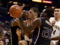 Jamal Boykin battles for the rebound against Quincy Pondexter. The Washington Huskies defeated the California Golden Bears 79-75 during the championship game of the Pacific Life Pac-10 Conference Tournament at Staples Center in Los Angeles, California on March 13th, 2010.
