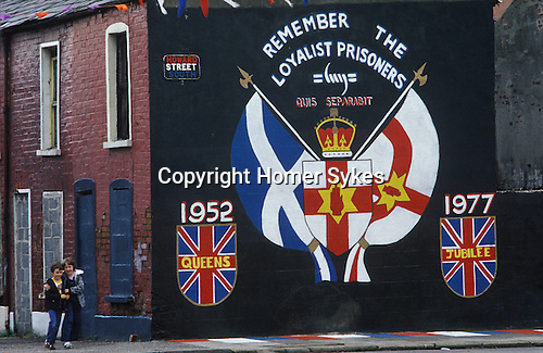 Belfast 1980s. The Troubles. Red Hand Commandos wall painting political poster in Howard Street. Boarded up houses, families moved out of Protestant enclave.