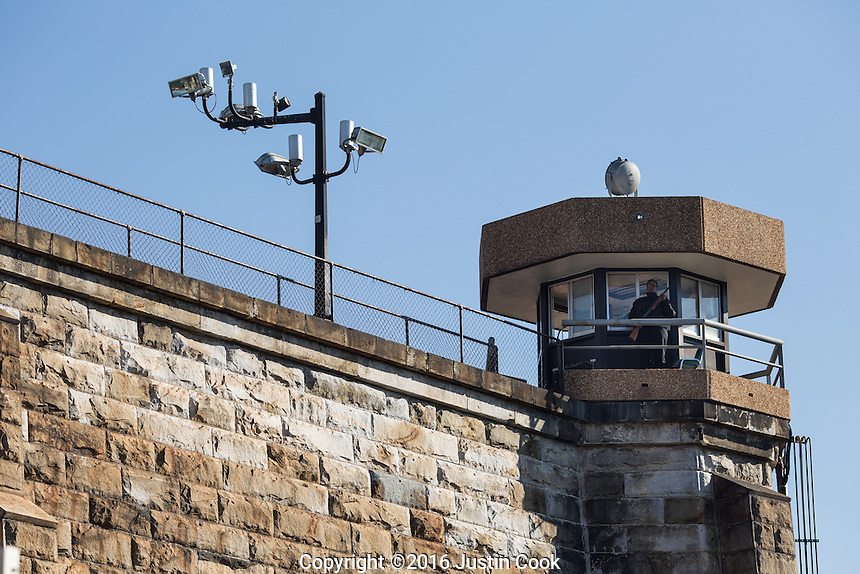 A tower guard watches over the yard at Central Prison in Raleigh, NC on Thursday, November 17, 2016. (Justin Cook)